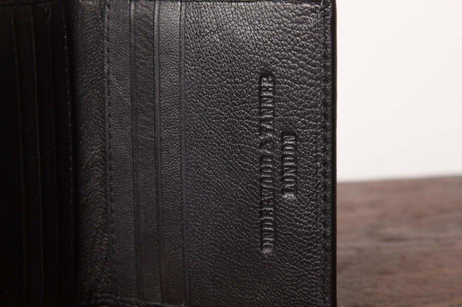 Lille sort læderpung fra Underwood and Tanner